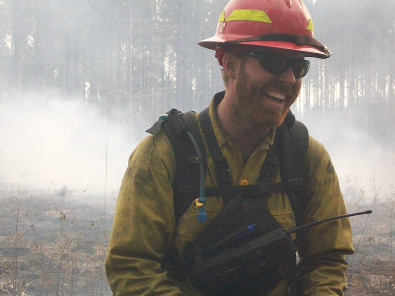 male firefighter smiling