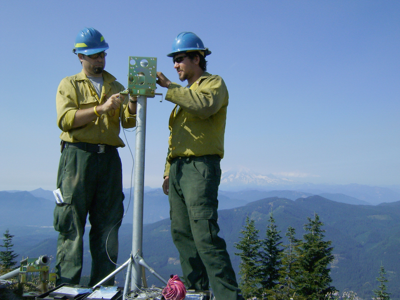monitoring fires from atop mountain